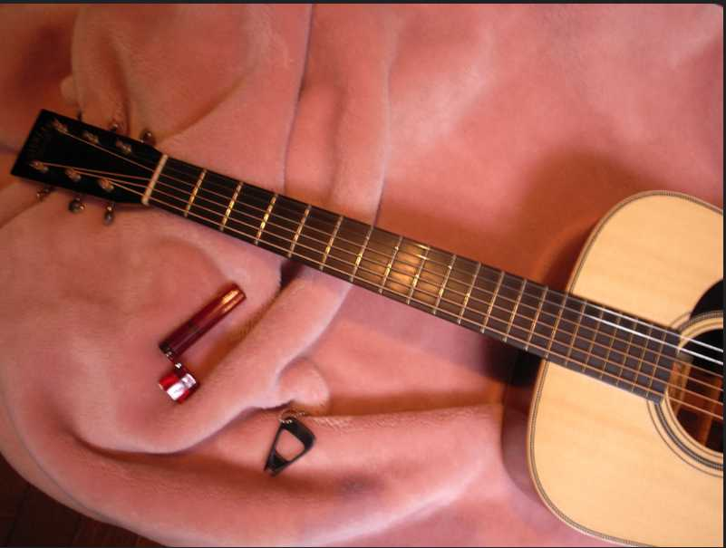 tools which are prepared for cleaning a guitar fretboard
