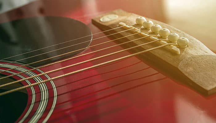 illustrative image of Coated Vs. Uncoated Guitar Strings 3