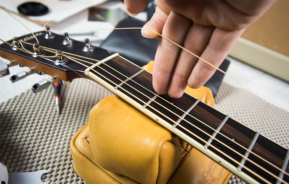 illustrative image of guitar strings