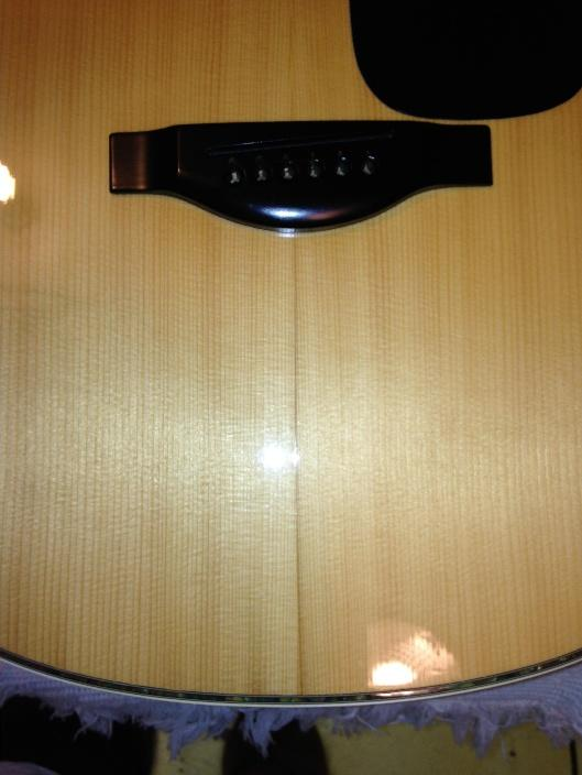 common indications of dryness on your acoustic guitar